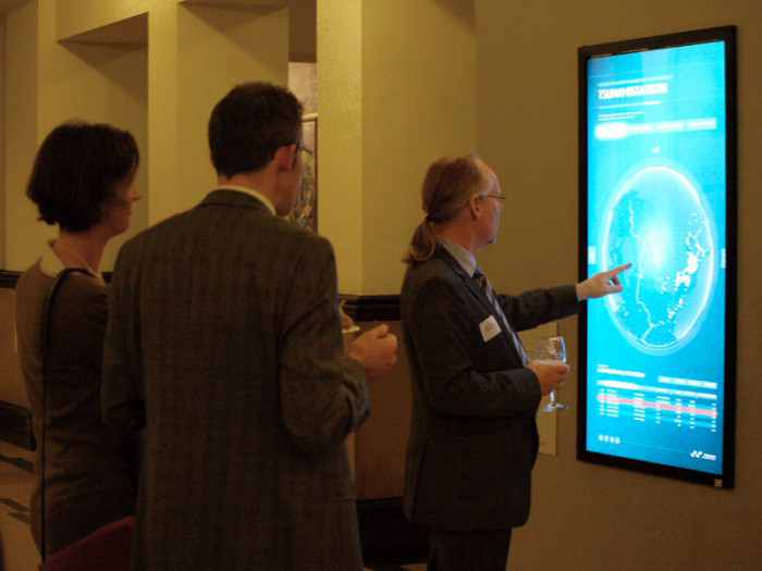 People looking at the Next Generation Scientific Poster
